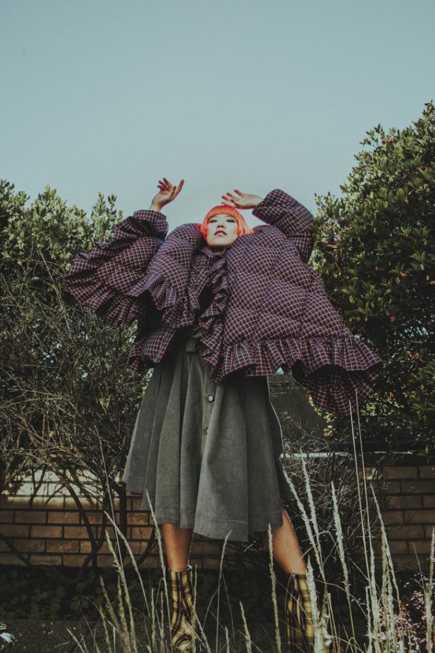 Fashion-editorial-with-maison-birks-and-laurence-and-chico-in-french-style-waring-purple-coat-with-squares